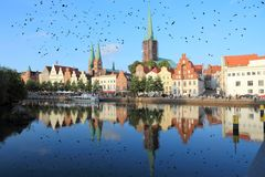 Lubeck Old Town. Germany. Ominous black birds royalty free stock photography