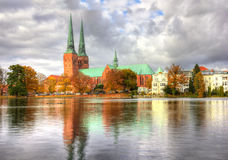 Lubeck, old town reflected in Trave river Royalty Free Stock Photography