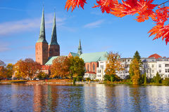 Lubeck old town reflected in Trave river, old town Royalty Free Stock Photos