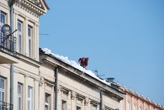 Man cleaning roof Royalty Free Stock Photography