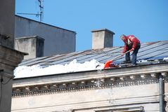 Man cleaning roof Stock Photos