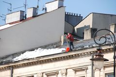 Man cleaning roof Stock Images