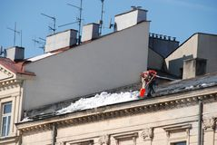 Man cleaning roof Royalty Free Stock Image