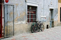 Lublin city street landscape, two bicycles are located near the wall, no people in the street royalty free stock images