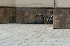 Lublin city street landscape, single bicycle is located near the wall, no people in the street royalty free stock images
