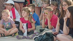 Kids in Crowd Watching Street Performance Stock Image