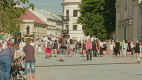 People Walk Along the Square Summer Day in Lublin Royalty Free Stock Photos