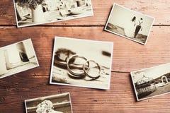 Ślubne fotografie na stole Zdjęcia Stock