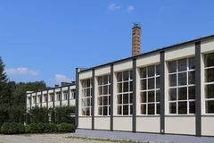 Lubno, Poland - july 9 2018: The modern sports hall of the village school. The eduction building of the younger generation. Walls stock images