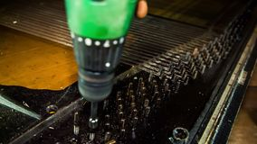 Lubricate the piano bolts before unscrewing them. Lubricate the piano bolts that hold the strings, before unscrewing them with a screwdriver stock video footage