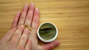 Lubricates cream cannabis hemp on hand medicinal cannabidiol CBD, body massage relaxed effect, relieves applying pain scrub,