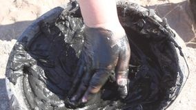 Mud therapy. Lubricating mud body care treatment stock video