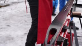 Preparation of cross-country skiing for competitions on the street in natural light stock footage