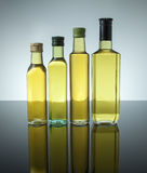 Lubrifichi in bottiglia ha sistemato quattro in una fila Fotografia Stock