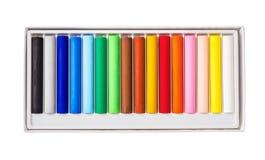 Lubrifichi il colore di pastelli in scatola isolata su fondo bianco Fotografie Stock Libere da Diritti