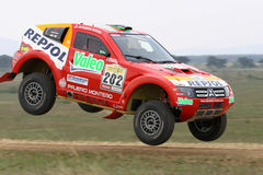 Luc Alphand jumping. Dakar rally winner Luc Alphand jumping with Mitsubishi on Central Europe Rally Stock Photos