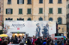 Lucca comics festival 2012, Tuscany,Italy. LUCCA,ITALY-NOV.04: stand of Assassin's creed III is set up during the 2012 edition of Lucca Comix Festival on fourth royalty free stock photography