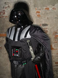 Lucca comics festival 2012, Tuscany,Italy. LUCCA,ITALY-NOV.04: man dressed like star wars characters Darth Vader poses at Lucca Comics Festival on fourth royalty free stock image