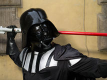 Lucca comics festival 2012, Tuscany,Italy. LUCCA,ITALY-NOV.04: man dressed like star wars characters Darth Vader poses at Lucca Comics Festival on fourth stock photo