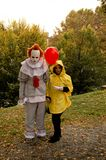 It at Lucca Comics and Games 2017. Stephen King`s creepy clown with the guy with the red ballon posing during the Lucca Comics and Games 2017 festival Royalty Free Stock Images
