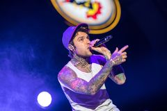 Fedez sings live on stage. Lucca, italia - july 13, 2017: Fedez he performs on stage during a summer music festival royalty free stock image