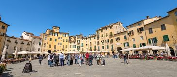 Piazza Anfiteatro - Lucca Tuscany Italy. LUCCA, ITALY - APRIL 16, 2017: Tourists and locals visit the ancient Town square Piazza dell`Anfiteatro - Amphitheater Stock Images