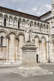 Lucca, Italy, statue of Francesco Burlamacchi, behind the cathed Stock Image