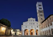 Lucca by night. The Cathedral of St. Martino with the belfry displays in Lucca Royalty Free Stock Photo