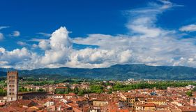 Lucca historic center skyline. Lucca old historic center skyline with medieval tower, amphitheater Square and clouds stock images