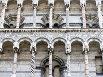 Lucca - San Michele. Richly sculptured facade of the romanesque style San Michele church in Lucca. Each  column is different, some carved, some twisted, some Royalty Free Stock Image