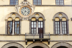 Lucca, windows and clock Royalty Free Stock Photo