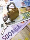 Lucchetto e dollaro, euro fotografia stock