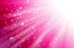 Luce astratta della stella con fondo rosa. Immagine Stock