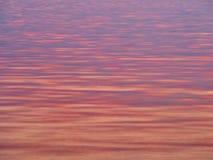 Luce Colourful di alba sull'acqua di mare delicatamente increspata, Grecia immagini stock libere da diritti