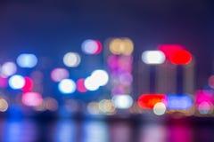 Luce del bokeh della sfuocatura, Hong Kong Harbour al tramonto Fotografie Stock Libere da Diritti