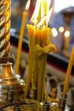 Luce della candela della chiesa Fotografie Stock