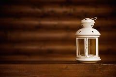 Luce della candela sul legno Fotografia Stock