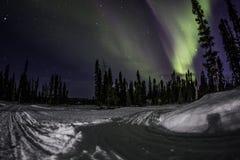 Luce di gatto delle nevi trail+northern Fotografia Stock