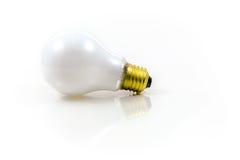 Luce di lampadina sopra i precedenti bianchi Fotografia Stock