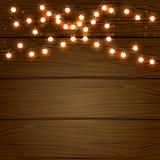 Luce di Natale su fondo di legno Immagini Stock Libere da Diritti