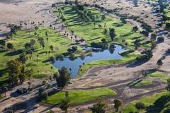 Luce di primo mattino sul campo da golf Fotografia Stock