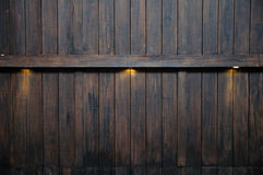 Luce di Ray sulla parete di legno antica Fotografia Stock
