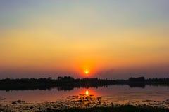 Luce di tramonto che riflette il fiume Fotografia Stock Libera da Diritti