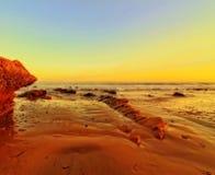 Luce dorata sulla spiaggia Fotografia Stock