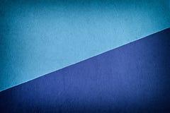 Luce e fondo blu scuro del feltro Immagine Stock