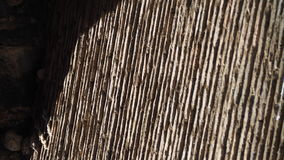 Luce ed ombre sulla parete del mattone e del mortaio Immagini Stock Libere da Diritti