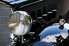 Luce nera d'annata della testa dell'automobile Fotografie Stock Libere da Diritti