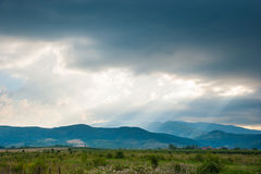 Luce solare attraverso le nubi Fotografia Stock Libera da Diritti