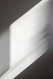 Luce sulla parete bianca Fotografia Stock