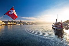 Lucern lake and town waterfront in morning mystic fog view. Famous destination in Switzerland stock image